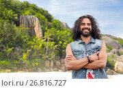Купить «smiling hippie man in denim vest on island beach», фото № 26816727, снято 27 августа 2015 г. (c) Syda Productions / Фотобанк Лори