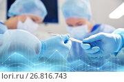 Купить «close up of hands with scalpel at operation», фото № 26816743, снято 23 декабря 2015 г. (c) Syda Productions / Фотобанк Лори