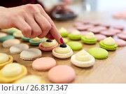 Купить «chef decorating macarons shells at pastry shop», фото № 26817347, снято 8 мая 2017 г. (c) Syda Productions / Фотобанк Лори