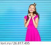 happy young woman or teen girl in pink dress. Стоковое фото, фотограф Syda Productions / Фотобанк Лори