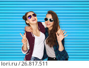 Купить «smiling teenage girls in sunglasses showing peace», фото № 26817511, снято 19 декабря 2015 г. (c) Syda Productions / Фотобанк Лори