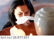 Купить «woman with cremation urn at funeral in church», фото № 26817651, снято 20 марта 2017 г. (c) Syda Productions / Фотобанк Лори