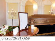 Купить «photo frame and coffin at funeral in church», фото № 26817659, снято 20 марта 2017 г. (c) Syda Productions / Фотобанк Лори