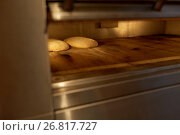 Купить «yeast bread dough in oven at bakery kitchen», фото № 26817727, снято 16 мая 2017 г. (c) Syda Productions / Фотобанк Лори