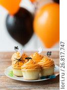 Купить «halloween party cupcakes or muffins on table», фото № 26817747, снято 6 июля 2017 г. (c) Syda Productions / Фотобанк Лори