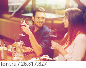 Купить «couple dining and drinking wine at restaurant», фото № 26817827, снято 8 ноября 2015 г. (c) Syda Productions / Фотобанк Лори