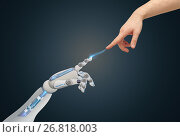 human and robot hands reaching to each other. Стоковое фото, фотограф Syda Productions / Фотобанк Лори