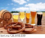 Купить «beer glasses, barrel and pretzel over cereal field», фото № 26818039, снято 22 июля 2016 г. (c) Syda Productions / Фотобанк Лори