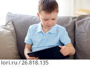 Купить «little boy with tablet pc computer at home», фото № 26818135, снято 18 апреля 2017 г. (c) Syda Productions / Фотобанк Лори