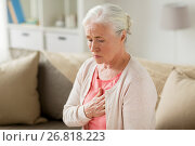 senior woman suffering from heartache at home. Стоковое фото, фотограф Syda Productions / Фотобанк Лори