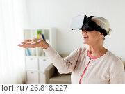 Купить «old woman in virtual reality headset or 3d glasses», фото № 26818227, снято 20 июня 2017 г. (c) Syda Productions / Фотобанк Лори
