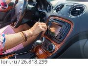 Купить «man driving car and turning switch on dashboard», фото № 26818299, снято 27 июля 2017 г. (c) Syda Productions / Фотобанк Лори