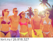 smiling friends in sunglasses on summer beach. Стоковое фото, фотограф Syda Productions / Фотобанк Лори