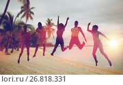 happy friends dancing and jumping on beach. Стоковое фото, фотограф Syda Productions / Фотобанк Лори