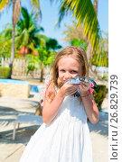 Купить «Adorable little girl with a small turtle in her hands in the natural reserve», фото № 26829739, снято 10 апреля 2017 г. (c) Дмитрий Травников / Фотобанк Лори