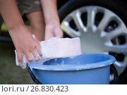 Купить «Teenage boy washing a car», фото № 26830423, снято 3 февраля 2017 г. (c) Wavebreak Media / Фотобанк Лори