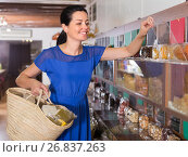 Купить «Female is choosing sweet dry fruits», фото № 26837263, снято 13 июня 2017 г. (c) Яков Филимонов / Фотобанк Лори