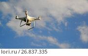 Купить «White unmanned aerial vehicle flies against a sky», видеоролик № 26837335, снято 21 июня 2017 г. (c) Володина Ольга / Фотобанк Лори