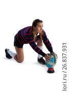 Side view of female athlete keeping rugby ball on tee. Стоковое фото, агентство Wavebreak Media / Фотобанк Лори