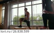 Купить «Young attractive girl and muscular man fitness instructor doing box jump exercise during a workout at the gym», видеоролик № 26838599, снято 20 апреля 2018 г. (c) Константин Шишкин / Фотобанк Лори