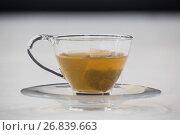 Купить «Green tea with tea bag in cup», фото № 26839663, снято 11 апреля 2017 г. (c) Wavebreak Media / Фотобанк Лори