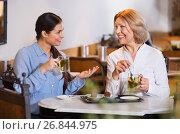 Купить «Portrait of two pleasant women with tea and chocolates», фото № 26844975, снято 18 июля 2018 г. (c) Яков Филимонов / Фотобанк Лори