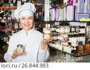 Купить «Woman selling chocolates and confectionery», фото № 26844983, снято 31 марта 2020 г. (c) Яков Филимонов / Фотобанк Лори