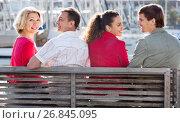 Купить «Happy family of four enjoying together near sea», фото № 26845095, снято 19 ноября 2019 г. (c) Яков Филимонов / Фотобанк Лори