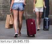 Купить «young tourist women friends walk in town with suitcase», фото № 26845155, снято 29 мая 2017 г. (c) Яков Филимонов / Фотобанк Лори