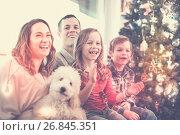 Купить «Cheerful family members spending Christmas time», фото № 26845351, снято 23 декабря 2016 г. (c) Яков Филимонов / Фотобанк Лори