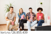 Купить «happy friends with popcorn watching tv at home», фото № 26855439, снято 14 августа 2016 г. (c) Syda Productions / Фотобанк Лори