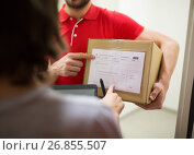 Купить «delivery man with box, tablet pc and customer», фото № 26855507, снято 3 декабря 2016 г. (c) Syda Productions / Фотобанк Лори