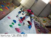 Купить «Teenage girl practicing rock climbing in fitness studio», фото № 26856151, снято 10 мая 2017 г. (c) Wavebreak Media / Фотобанк Лори