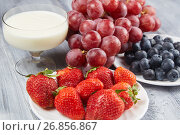 Strawberry, blueberry with yogurt and grapes on a gray wooden background. Стоковое фото, фотограф Алексей Спирин / Фотобанк Лори