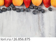 Strawberries, blueberries, apricot t on a wooden board. Стоковое фото, фотограф Алексей Спирин / Фотобанк Лори