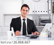 Купить «Successful businessman using laptop», фото № 26868667, снято 20 апреля 2017 г. (c) Яков Филимонов / Фотобанк Лори