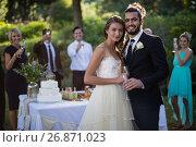 Купить «Newly married couple holding glasses of champagne», фото № 26871023, снято 2 мая 2017 г. (c) Wavebreak Media / Фотобанк Лори