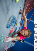 Купить «Determined teenage girl practicing rock climbing», фото № 26871879, снято 10 мая 2017 г. (c) Wavebreak Media / Фотобанк Лори