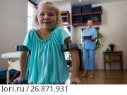 Купить «Portrait of smiling girl with crutches», фото № 26871931, снято 23 апреля 2017 г. (c) Wavebreak Media / Фотобанк Лори