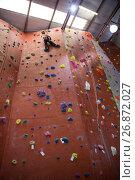 Купить «Determined boy practicing rock climbing», фото № 26872027, снято 10 мая 2017 г. (c) Wavebreak Media / Фотобанк Лори