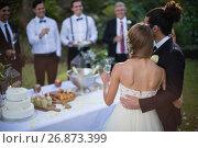 Купить «Newly married couple holding glasses of champagne», фото № 26873399, снято 2 мая 2017 г. (c) Wavebreak Media / Фотобанк Лори