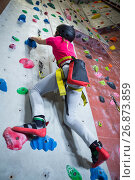 Купить «Teenage girl practicing rock climbing», фото № 26873859, снято 10 мая 2017 г. (c) Wavebreak Media / Фотобанк Лори