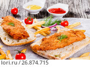 Купить «sandwich with ciabatta and Bread Crumb Coated fried pork chop», фото № 26874715, снято 18 января 2019 г. (c) Oksana Zh / Фотобанк Лори