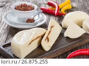 Купить «Homemade mozzarella  stuffed with adjika or red pesto», фото № 26875255, снято 13 июля 2020 г. (c) Oksana Zh / Фотобанк Лори