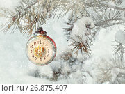 New Year and Christmas background in vintage tones. New Year Christmas toy on snowy fir tree branch, фото № 26875407, снято 5 января 2016 г. (c) Зезелина Марина / Фотобанк Лори