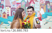 Купить «Loving young couple doing selfie on wall background», видеоролик № 26880783, снято 5 сентября 2017 г. (c) Happy Letters / Фотобанк Лори