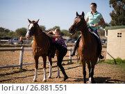 Купить «Female friends preparing for horse background», фото № 26881551, снято 3 мая 2017 г. (c) Wavebreak Media / Фотобанк Лори