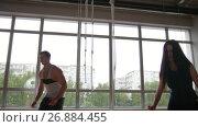 Купить «Sporty woman and muscular man fitness instructor doing box jump exercise during a workout at the gym», видеоролик № 26884455, снято 20 апреля 2018 г. (c) Константин Шишкин / Фотобанк Лори