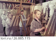 Купить «schoolgirls diligently training their painting skills during class at art studio», фото № 26885115, снято 23 мая 2019 г. (c) Яков Филимонов / Фотобанк Лори