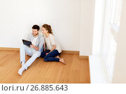 Купить «happy couple with tablet pc computer at new home», фото № 26885643, снято 4 июня 2017 г. (c) Syda Productions / Фотобанк Лори